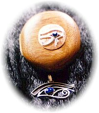 photo of Sterling Silver Eye of Horus pendant with Lapis Lazuli cabochon and matching hand crafted Australian Black Bean wood, velvet lined jewellery box.  Features an Eye of Horus in copper and silver set with a Lapis Lazuli and silver knob on the lid